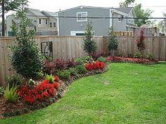 Flower beds along fence line
