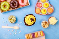 cupcake with chocolate bar donuts and macaroons
