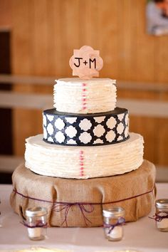 black and white wedding cake with burlap cake stand. rustic + contemporary