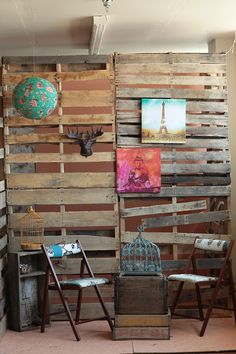 the palets are a good idea if you have brick walls so that way you can still hang art work and it have an industrial feeling art stand
