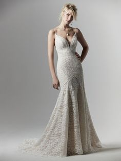 This sexy fit-and-flare boho wedding dress features geometric lace atop tulle, with delicate spaghetti straps completing the illusion plunging neckline and V-back. Finished with zipper closure and covered buttons trailing from back to hem. Lace Wedding Dress, Fit And Flare Wedding Dress, Bridal Dresses, Wedding Gowns, Prom Dresses, Vestidos Boutique, Boutique Dresses, Wedding Dress Boutiques, Designer Wedding Dresses