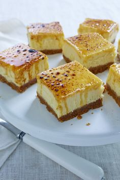 Creme Brulee Cheese Cake Squares  Crust:  9 whole graham crackers     ½ stick unsalted butter, melted     For the filling:     2 (8-ounce) packages cream cheese, at room temperature     1 cup granulated sugar     2 large eggs     1 large egg yolk     1 vanilla bean, split and scraped     ½ teaspoon fine sea salt     For the brulee topping:     ¼ cup granulated sugar