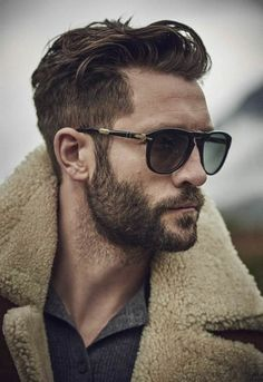 Notice how both the beard and the sides of the head are neatly trimmed while the top of the head is left longer to create visual interest.