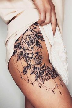 Rose thigh tattoo is a big trend among women right now. If you didn't want a new tattoo before, you will after this. Here are the best 23 designs. Side Thigh Tattoos Women, Side Hip Tattoos, Hip Thigh Tattoos, Floral Thigh Tattoos, Sexy Tattoos, Skull Tattoos, Hip Tattoos For Women, Upper Leg Tattoos, Tattoed Women