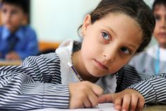 Classes Start Again for Young Palestinians at UNRWA School. A close-up of a Palestinian girl during one of the first classes of the new academic year, at a school in Gaza supported by the United Nations Relief and Works Agency for Palestine Refugees in the Near East (UNRWA).  5 September 2011. Gaza. UN Photo/Shareef Sarhan