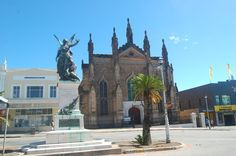 In High Street, the Methodist Commemoration Church with the Winged Memorial of Peace to the left.