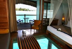 LOVE this suite in Bora Bora  glass floor  surf board table  island living