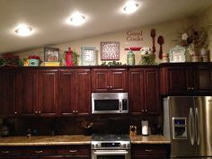 way too much going on for my taste, but I can use my decal above the kitchen cabinets like this!