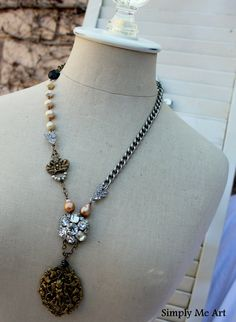 Vintage Rhinestone, Brass Finding, Pearl and Gemstone Assemblage Necklace...Cherub. $94.00, via Etsy.