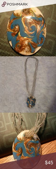 """*New List* Stunning Murano Glass Pendant Necklace This stunningly gorgeous authentic Murano glass pendant and glass bead necklace was made in Italy, bought in Greece. I have worn it two times. Perfect condition with no chips or cracks.  The 6 strand glass bead necklace is 18th """" long. Murano Jewelry Necklaces"""
