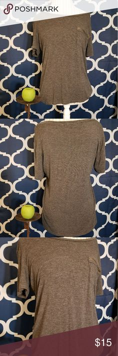 🌻🌺🌻CUTE LOOSE FITTING SHIRT-LIKE NEW!! CUTE LOOSE FITTING SHIRT-LIKE NEW!! Size large. Soft and stretchy! Has pocket in the front. Color is a dark heather gray. No flaws, like new. Posh Ambassador, buy with confidence! Check out my other items to bundle and save on shipping! Reasonable offers welcome. I ship same or next day!    Inventory #RA48 occasion Tops