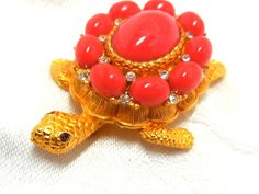 Stunning CADORO Turtle brooch is a Statement piece.  Cabochons of Bright Orange glass, crystal Rhinestones, Red rhinestone eyes and a very detailed
