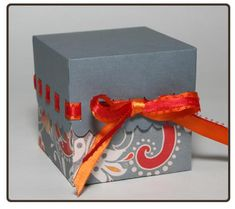 Give a sweet treat to that special someone in this dainty gift box. The small slits in the lid allow you to weave ribbon to coordinate with the box for the perf