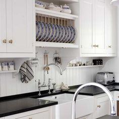 Kvanum - Crisp white kitchen with black quartz countertops - beadboard backsplash