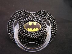 Rhinestoned Pacifier Superhero Blinky $35.00 In case the tiny choking and intestinal obstruction hazards glued to it don't turn you off. You wanna look cool, forget about your kids' safety.