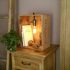 Lamp in a wooden wine case, vintage style with incandescent light .