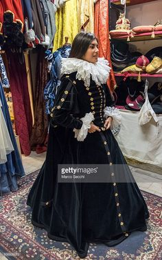 Irene Rizzi, this year Angelo at Venice Carnival, wears a 1600 costume created for Fondazione Buccellati that includes many 24kt gold buttons on January 26, 2016 in Venice, Italy. Atelier Pietro Longhi, a Venetian costumier specialising in historic clothing, supply theatres and major events worldwide and are at their busiest in the lead up to Venice carnival.