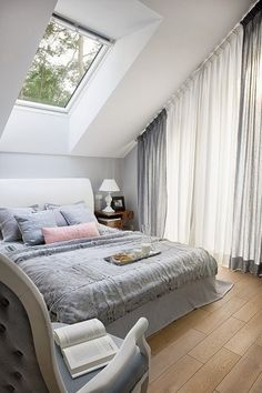 Love the beautiful sky light and the simple, neutral colors. :) Looks cozy.