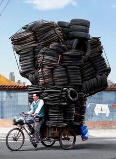 "These astounding images were captured by French photographer Alain Delorme . They are his latest series of photographs entitled ""Totems"" tha. People Around The World, Around The Worlds, Latest Series, Cargo Bike, Working People, French Photographers, Totems, Belle Photo, Funny Photos"