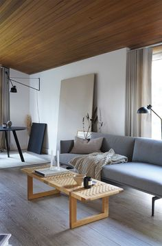 Minimal Nordic Bench by Carl Hansen & Son styled in a Scandinavian home. Bench or table you choose the function.