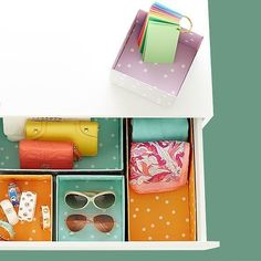 Colorful drawer organizers to sort your sunnies, scarves, and other accessories.