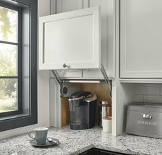 Wall Appliance Garage - The KraftMaid Difference, company history, environmental commitment, manufacturing process, careers - Buy Kitchen Cabinets, Kitchen Cabinet Design, Kitchen Storage, Kitchen Organization, Bathroom Cabinetry, Organization Ideas, Storage Ideas, Kitchen Appliances, Kitchen Cupboard