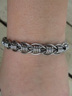 Women's stainless steel hand bent wire woven bracelet