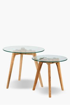 These nested sides tables are an ideal addition to your urban room setting. The glass top and angled oak veneer legs give them a stylish edge.