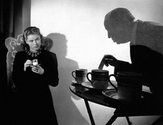 "Ingrid Bergman and Alfred Hitchcock on the set of ""Notorious"" (1946, dir. Alfred Hitchcock)."