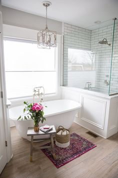 Gorgeous master bath remodel - love the freestanding tub and subway tile in the shower!