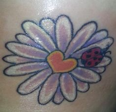Daisy tattoo, no ladybug and kids initials in the flower