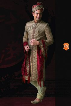 The Manyavar Mughal embroidered Sherwani for Men :- This sherwani is inspired from the mughal look with its intricate mughal stitching styles. Red threads tied close with matt finish light gold gives it a royal image.  #Manyavar #Sherwani #Wedding #Indian Wedding Wear #Manyavar Wedding Wear #Celebration Wear #Special Occasion #Indian Ethnic Wear