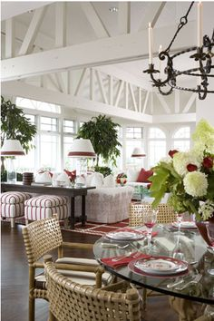 bright open dinning space/ family room with white with touches of red and lime green