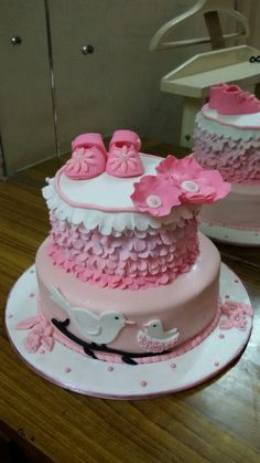 Chocolate flavoured cake for the naming ceremony of a lil girl.  Handmade pink sugar booties the baby loves and the two birds depicting mommy and baby!