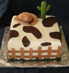 Cowboy Cake - I made this western theme cake for our church Chili cook-off activity. Chocolate-chocolate chip cake with cookies & cream filling. Buttercream with fondant decorations.