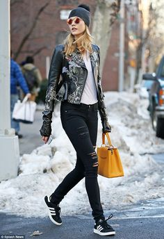 Pretty as a petal! The supermodeladded a feminine touch to her leather motorcycle jacket ...