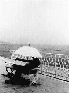 Waiting: man with a white umbrella.  1934.  Photo by Brassaï.