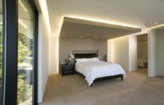 """This is a wonderful, but not cheap, way to """"lower"""" a too-high ceiling. Studies show that high ceilings create a feeling of formalness, not the kind of feeling you want in a bedroom! Feng shui wise: High ceilings dissipate chi and could effect sleep and health. Contemporary Bedroom by Mark English Architects, AIA"""