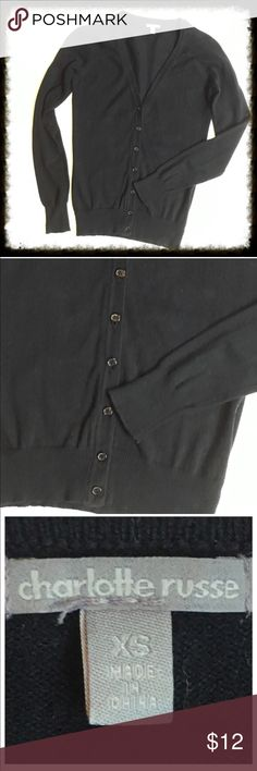 Charlotte Russe Black Cardigan Charlotte Russe Black cardigan in good condition. Long sleeves. 80% cotton 20% nylon. Machine wash. Lay flat to dry. 21 inches in length.  Armpit to armpit measures 14 inches across.   *15% off bundles *No trades *Reasonable offers are always considered *Happy poshing 🙂 Charlotte Russe Sweaters Cardigans