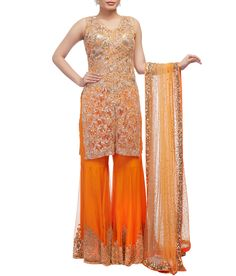 A lovely orange into gold lace kurta with front slit. Orange embellished shrara and gold into nude shaded net dupatta completes the ensemble. Neeta Lulla