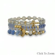 Set of 4 Gold Tone Multicharm Fashion Stretch Bracelets with Blue Stones www.gemijewels.com  $ 25.00