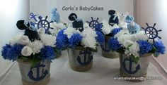 Nautical theme baby shower decorations - these were a custom request - Love the diaper baby poking his head of the middle of these arrangements!