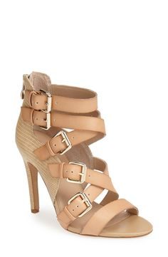 Check out the buckle detail on these strappy sandals!