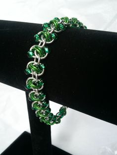 This bracelet is made using the rapid track chainmaille weave (a version of the barrel weave) and is 1/2 inch in width. The weave is made from
