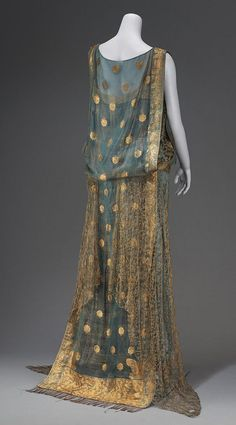 Evening dress, first quarter 20th century (clearly 1910s or 20s). Made in part from an Indian sari of blue and gold. Back