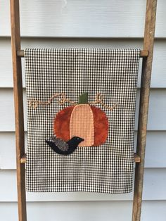 A personal favorite from my Etsy shop https://www.etsy.com/listing/251000245/primitive-pumpkin-tea-towel-autumn-wool