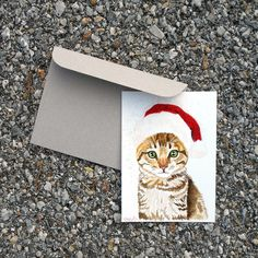 Christmas watercolor card Christmas cat Christmas pet with Santa Claus's hat Red glitter Christmas pet Christmas gift Watercolor painting - Christmas Gifts For Pets, Christmas Animals, Christmas Cats, Christmas Decor, Christmas Time, Watercolor Christmas Cards, Watercolor Cards, Watercolor Paintings, Kids World Map