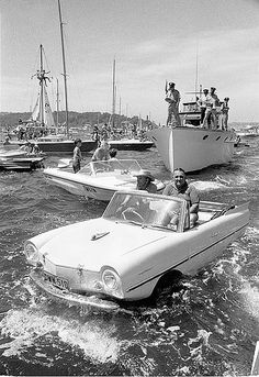 Start of the Sydney-Hobart Yacht Race, 1971    Format: 1 photonegative - 35 x 24 mm.    Notes: The Amphicar was a German vehicle manufactured 1960-1968. It was the first commercially produced amphibious car and used a Triumph Herald engine over the rear axle to power the wheels and twin propellors. In the water, the front wheels acted as rudders. The body was steel.    From the collections of the Mitchell Library, State Library of New South Wales www.sl.nsw.gov.au