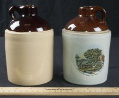 MINIATURE CROCKS, MADE IN USA. ONE IS BY CURRIER AND IVES AND THE OTHER ONE HAS NO MARKINGS. THE BOTTOM OF THE CROCKS ARE MADE OF STONEWARE AND THE REST IS MADE OF CERAMIC.