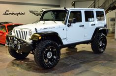 """2014 Jeep Wrangler Rubicon white, 20"""" XD wheels, 35 in toyo, 3.5"""" lift, carbon fiber covered fenders. I want this jeep!"""